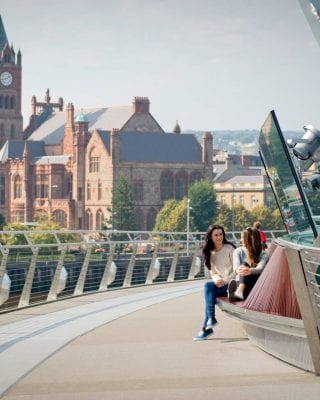 Friends Chatting on the Peace Bridge in Derry