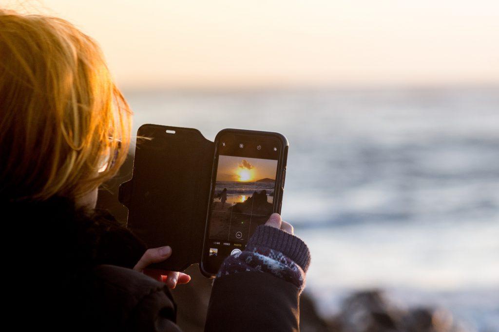 Woman on Holidays Using Phone - Maldron Hotel